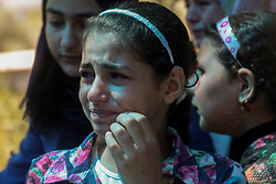 September 9, 2017 - Relatives of Palestinian teenager Qoteiba Yussef Zahran mourn the death of the boy during his funeral in the northern West Bank village of Illar, near the town of Tulkarem. The boy had died on 19th August 2017 after being shot and wounded and left to bleed to death by Israeli border control officers at the Za'tara checkpoint, following an alleged attempted stabbing of an Israeli border guard by the boy. After the event, Israeli forces entered Zahran's village, Illar, arrested his brother Tareq, and took him to an interrogation centre, where he is been hold without charges, and without access to a lawyer (Credit Image: © Mohammed Turabi/ImagesLive via ZUMA Wire)