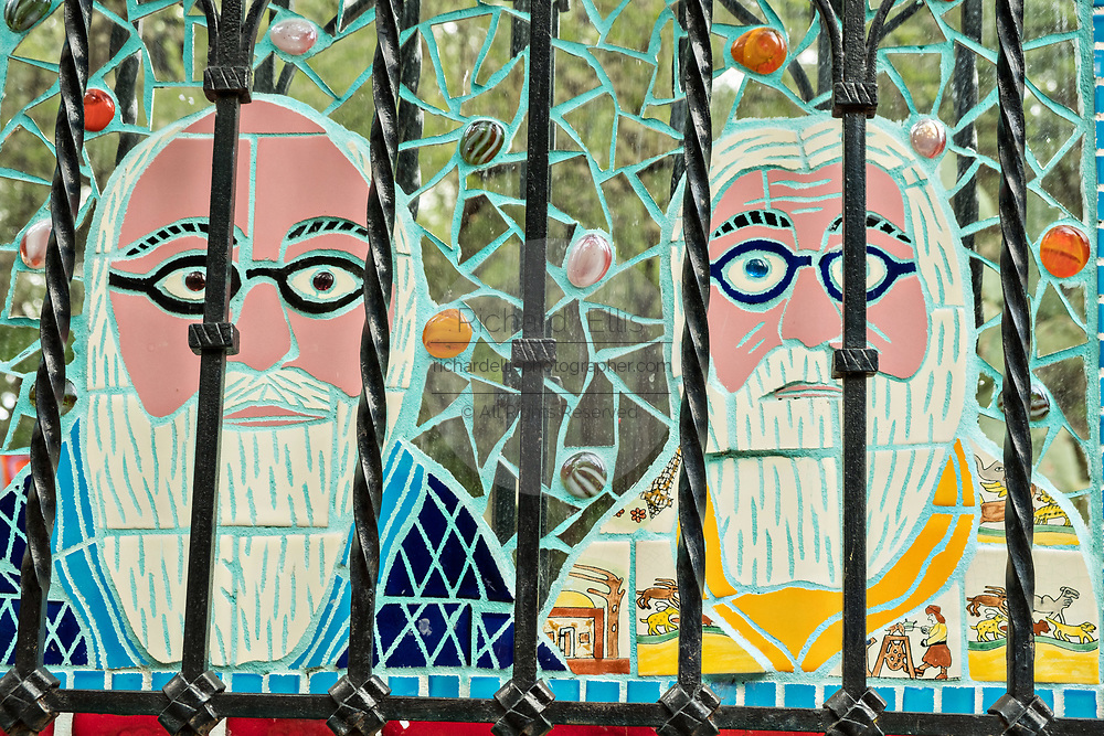 A tile mosaic portrait of American artist Anado McLauchlin, right, and his husband Richard Schultz along the wall of the Chapel of Jimmy Ray in the art compound Casa las Ranas September 28, 2017 in La Cieneguita, Mexico.