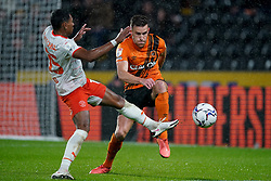Blackpool's Demi Mitchell battles with Hull City's Callum Elder during the Sky Bet Championship match at the MKM Stadium, Hull. Picture date: Tuesday September 28, 2021.