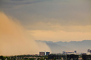 "18 AUGUST 2011 - PHOENIX, AZ:  A ""haboob"" or dust storm moves from the suburb of Tempe to downtown Phoenix Thursday. A haboob (Arabic for ""strong wind"") is a type of intense duststorm commonly observed in arid regions throughout the world. They have been observed in the Sahara desert, the Arabian Peninsula, throughout Kuwait, and most arid regions of Iraq. In the USA, they are frequently observed in the deserts of Arizona, including Yuma and Phoenix, as well as New Mexico and Texas. ""Haboob"" has been widely used to describe dust storms for more than a generation In Arizona but this year the very word ""haboob"" has become a political football because some conservatives have lobbied against use of the word, favoring English words, like ""dust storm.""     PHOTO BY JACK KURTZ"