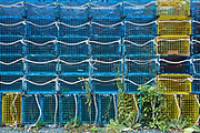 Brightly coloured lobster baskets cages in stacks at Gloucester Harbor, Massachusetts, USA