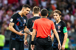July 11, 2018 - Moscow, Russia - 180711 Dejan Lovren and Luka Modric of Croatia in a discussion with referee Cuneyt Cakir during the FIFA World Cup semi final match between Croatia and England on July 11, 2018 in Moscow..Photo: Petter Arvidson / BILDBYRÃ…N / kod PA / 92085 (Credit Image: © Petter Arvidson/Bildbyran via ZUMA Press)