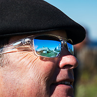 Visitor to Monhegan Island catches the reflection in his sunglasses of the historic Island Inn.