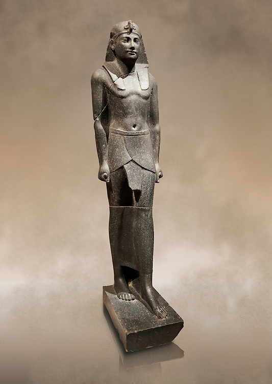 Ancient Ptolemaic Egyptian basalt statue of Ptolemy III, 220 BC . Neues Museum Berlin. Cat No: 14764 .<br /> <br /> If you prefer to buy from our ALAMY PHOTO LIBRARY  Collection visit : https://www.alamy.com/portfolio/paul-williams-funkystock/ancient-egyptian-art-artefacts.html  . Type -   Neues    - into the LOWER SEARCH WITHIN GALLERY box. Refine search by adding background colour, subject etc<br /> <br /> Visit our ANCIENT WORLD PHOTO COLLECTIONS for more photos to download or buy as wall art prints https://funkystock.photoshelter.com/gallery-collection/Ancient-World-Art-Antiquities-Historic-Sites-Pictures-Images-of/C00006u26yqSkDOM