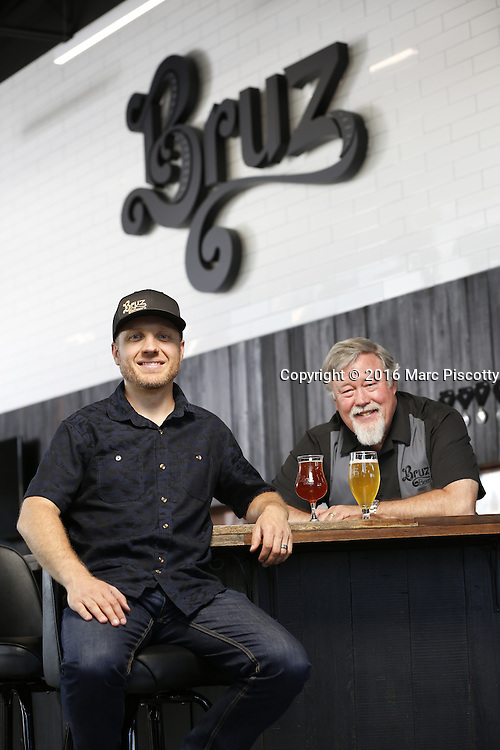 SHOT 7/22/16 1:47:56 PM - Bruz Beers co-founders Charlie Gottenkieny and Ryan Evans inside the new brewery near 67th Avenue and Pecos in Denver, Co. Bruz Beers is Denver's artisanal Belgian-style brewery, featuring a full line of traditional and Belgian-inspired brews, hand-crafted in small batches. Includes images of Evan's dog 'Cooper' as well who serves as the brewery dog. (Photo by Marc Piscotty / © 2016)