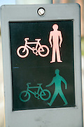 Red and green man on road crossing