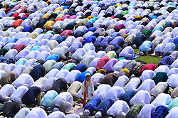 June 26, 2017 - Dimapur, Nagaland, India - A kid looks on as Indian Muslim devotees offer Eid prayers at the start of the Eid-al-Fitr marking the end of the Ramadan in Dimapur, India north eastern state of Nagaland. Muslims around the world are celebrating Eid-al-Fitr which marks the end of the fasting month of Ramadan. (Credit Image: © Caisii Mao/NurPhoto via ZUMA Press)