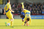 Sean McConville of Accrington Stanley falls over Sean Rigg of AFC Wimbledon. Skybet football league two play off semi final, 1st leg match, AFC Wimbledon v Accrington Stanley at the Cherry Red Records Stadium in Kingston upon Thames, Surrey on Saturday 14th May 2016.<br /> pic by John Patrick Fletcher, Andrew Orchard sports photography.