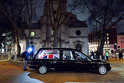 © Licensed to London News Pictures. 15/04/2013. London, UK A photographer takes a picture as the hearse that will carry the coffin arrives at St Clement Danes Church. A full rehearsal of the funeral of former British Conservative Prime Minster Baroness Thatcher takes place in central London. Hundreds of members of the armed forces drawn from all three services took part in the practice in the early hours of 15th April 2013. Photo credit : Stephen Simpson/LNP