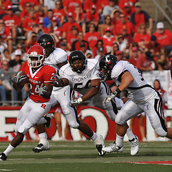 Sep 7, 2009; Piscataway, NJ, USA; Rutgers wide receiver Mason Robinson (24) avoids tacklers during the first half of Rutgers game against Cincinnati in NCAA college football at Rutgers Stadium.