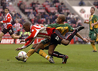 Photo. Glyn Thomas.<br /> Sunderland v West Bromwich Albion. <br /> Nationwide Division 1. 18/04/2004.<br /> Sunderland's Darren Byfield (L) battles for the ball with James Chambers.