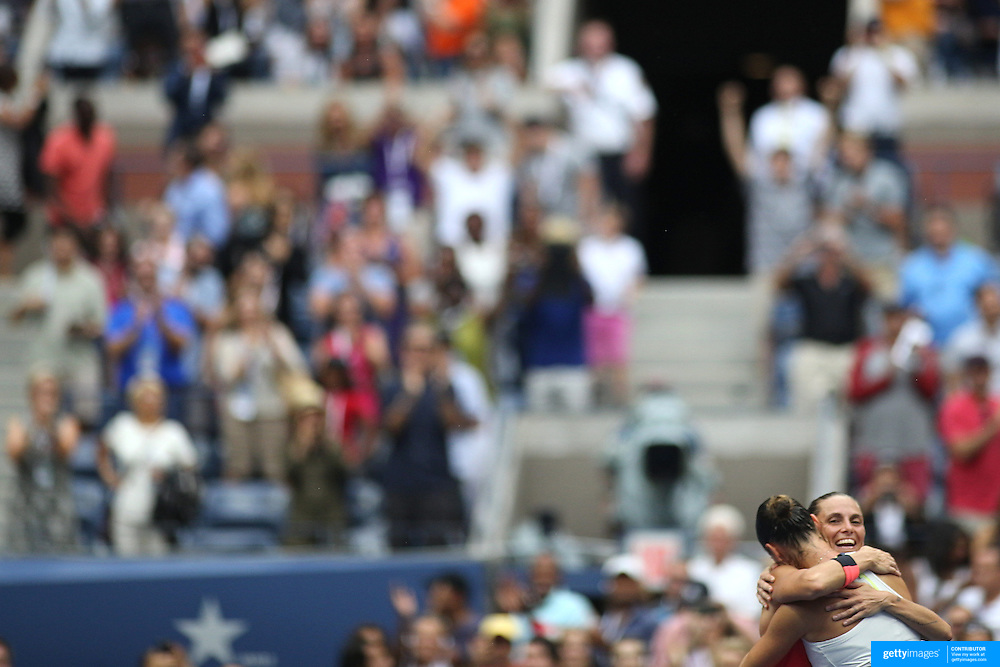 Flavia Pennetta, Italy, celebrates victory as she is embraced at the net by Roberta Vinci Italy, in the Women's Singles Final match during the US Open Tennis Tournament, Flushing, New York, USA. 12th September 2015. Photo Tim Clayton