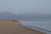 People on Newborough Beach on 17th September 2020 in Newborough, Anglesey, Wales, United Kingdom. Known in Welsh as Llanddwyn Beach, it is a Blue Flag Beach backed by Newborough National Nature Reserve and forest on the south-western tip of Anglesey.