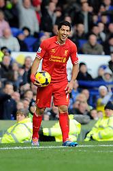 Liverpool's Luis Suarez laughs off a decision made by the linesman - Photo mandatory by-line: Dougie Allward/JMP - Tel: Mobile: 07966 386802 23/11/2013 - SPORT - Football - Liverpool - Merseyside derby - Goodison Park - Everton v Liverpool - Barclays Premier League