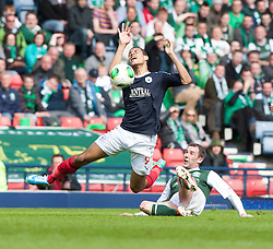 Falkirk's Lyle Taylor tackled by Hibernian's Kevin Thomson..Hibernian 4 v 3 Falkirk, William Hill Scottish Cup Semi Final, Hampden Park..©Michael Schofield..