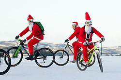 © under license to London News Pictures.  18/12/2010 Bikers from a local Plymouth bike club dressed as Santa cycle on Plymouth Hoe this morning (18/12/2010). Snow and cold weather has hit much of the South West of England. Picture credit should read: David Hedges/LNP.