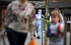 © Licensed to London News Pictures. 20/05/2016. London, UK. Police and a member of a police forensics team at Sainsbury's in Hampton after four women were reportedly stabbed at the supermarket. Photo credit: Ben Cawthra/LNP