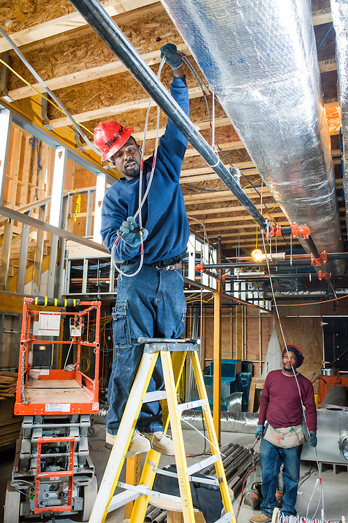 Electricians working on the Bromley Heath Learning Center in Jamaica Plain, MA.