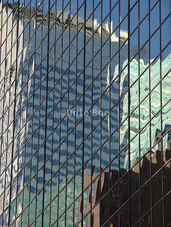Reflection of office high rise Citicorp Center in a huge glass high rise building.