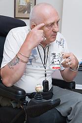 Male wheelchair user having a cup of tea;