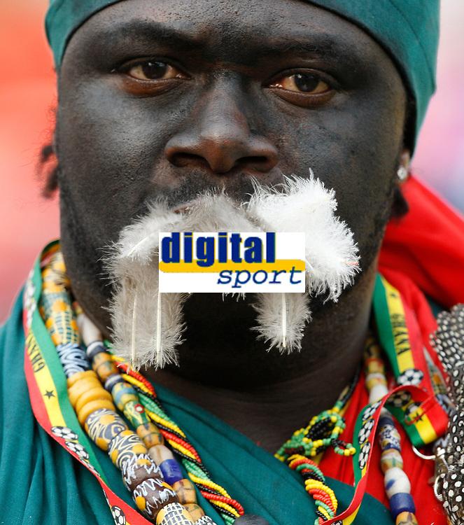 Photo: Steve Bond/Richard Lane Photography.<br />Ghana v Guinea. Africa Cup of Nations. 20/01/2008. Ghana fan spits feathers