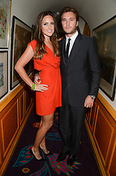 BEN & ELLE CARING at an exhibition of the 50 best party pictures from Tatler from the past 50 years, held at Annabel's, Berkeley Square, London on 9th September 2013.