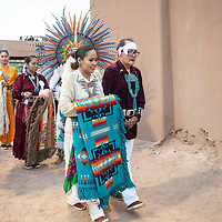 The contestants for Miss Gallup Inter-Tribal Ceremonial Queen walk out onto the rodeo grounds for the coronation of the 2018-2019 queen at Red Rock Park, Friday August 10, 2018.