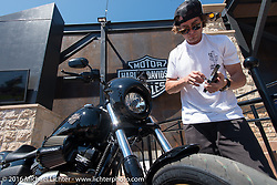 Jesse Rooke at the Harley-Davidson Rally Point Plaza during the Annual Sturgis Black Hills Motorcycle Rally.  SD, USA.  August 7, 2016.  Photography ©2016 Michael Lichter.