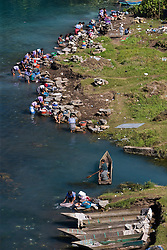 Villagers doing laundry in Lake Atitlán, Santiago Atitlán Guatemala