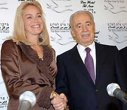SHIMON PERES (2 August 1923 - 28 September 2016) was a Polish-born Israeli statesman. Born Szymon Perski, he was the ninth President of Israel from 2007 to 2014, served twice as the Prime Minister of Israel and twice as Interim Prime Minister, and he was a member of 12 cabinets in a political career spanning over 66 years. Peres won the 1994 Nobel Peace Prize together with Yitzhak Rabin and Yasser Arafat for the peace talks that he participated in as Israeli Foreign Minister, producing the Oslo Accords. PICTURED: Mar 8, 2006 - Tel Aviv, Israel - Actress SHARON STONE during a press conference with President SHIMON PERES of Israel. (Credit Image: © Israel Hadari/ZUMAPRESS.com)
