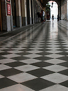 black and white squared tiles on a corridor floor