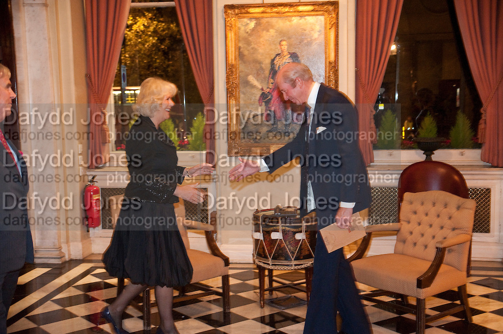 CAMILLA DUCHESS OF CORNWALL IS GREETED BY NICHOLAS PETO, The Lady Joseph Trust, fundraising party.<br /> Camilla, Duchess of Cornwall  attends gala fundraising event as newly appointed President of the charity. The Lady Joseph Trust was formed in 2009 to raise funds to acquire horses for the UKÕs top Paralympic riders Cavalry and Guards Club, 127 Piccadilly, London,<br /> 26 October 2011. <br /> <br />  , -DO NOT ARCHIVE-© Copyright Photograph by Dafydd Jones. 248 Clapham Rd. London SW9 0PZ. Tel 0207 820 0771. www.dafjones.com.<br /> CAMILLA DUCHESS OF CORNWALL IS GREETED BY NICHOLAS PETO, The Lady Joseph Trust, fundraising party.<br /> Camilla, Duchess of Cornwall  attends gala fundraising event as newly appointed President of the charity. The Lady Joseph Trust was formed in 2009 to raise funds to acquire horses for the UK's top Paralympic riders Cavalry and Guards Club, 127 Piccadilly, London,<br /> 26 October 2011. <br /> <br />  , -DO NOT ARCHIVE-© Copyright Photograph by Dafydd Jones. 248 Clapham Rd. London SW9 0PZ. Tel 0207 820 0771. www.dafjones.com.