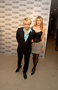 Nick Rhodes and Meredith Ostron, M.A.C. Viva glam V lipstick launch dinner, profits go to the MAC Aids fund,   Hempel Garden. ONE TIME USE ONLY - DO NOT ARCHIVE  © Copyright Photograph by Dafydd Jones 66 Stockwell Park Rd. London SW9 0DA Tel 020 7733 0108 www.dafjones.com