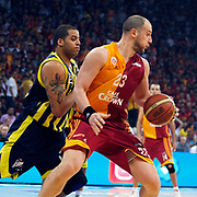 Galatasaray's Ermal KURTOGLU (R) and Fenerbahce Ulker's Fenerbahce Ulker's Sean Gregory MAY (L) during their Turkish Basketball league Play Off Final third leg match Galatasaray between Fenerbahce Ulker at the Abdi Ipekci Arena in Istanbul Turkey on Thursday 09 June 2011. Photo by TURKPIX