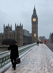 © under license to London News Pictures. 02/12/10. As snow falls on central London commuters make their way across Westminster Bridge this morning (02/12/2010).  Credit should read Matt Cetti-Roberts/London News Pictures