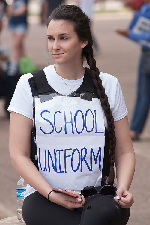 Madeline Burroughs dons a bullet proof jacket to protest the ongoing school shootings in the country during the March for Our Lives in front of Dallas City Hall in downtown Dallas.