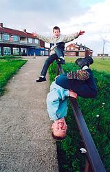 Children playing on run down council housing estate Bradford Yorkshire UK