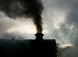© Licensed to London News Pictures. <br /> 01/10/2016. <br /> Grosmont, UK.  <br /> <br /> A locomotive leaves Grosmont station under steam as visitors and steam railway enthusiasts attend the North Yorkshire Moors Railway Autumn Steam Weekend. <br /> The hugely popular railway line runs a service between Pickering and Whitby through the picturesque North yorkshire countryside and attracts thousands of visitors each year. <br /> <br /> Photo credit: Ian Forsyth/LNP