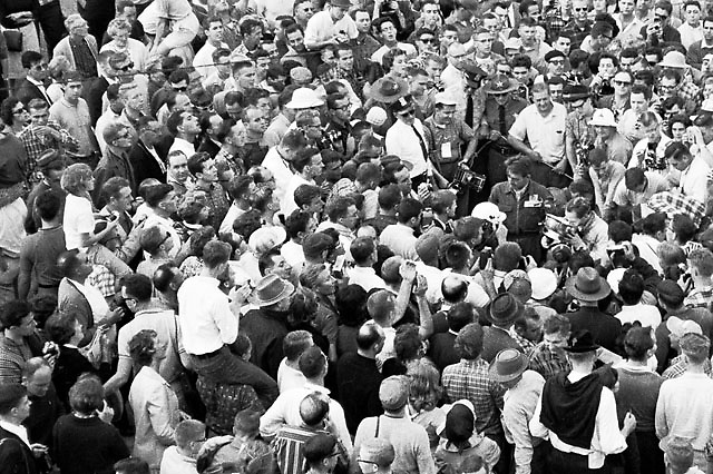 Innes Ireland, at right center drinking from trophy cup, winner of inaugural US Grand Prix at Watkins Glen, NY, 1961
