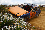 This is starting to look worrying for your photographer as a car heads straight up the beautifully flowered bank in the World Dirt Final during the race meeting at Smallfield Raceway, Surrey, UK on the 10th of July 2011 (photo by Andrew Tobin/SLIK images)
