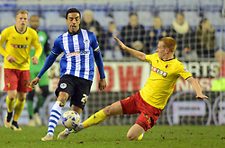 Watford's Ben Watson challenges Wigan's James Perch - Photo mandatory by-line: Richard Martin-Roberts/JMP - Mobile: 07966 386802 - 17/03/2015 - SPORT - Football - Wigan - DW Stadium - Wigan Athletic  v Watford - Sky Bet Championship