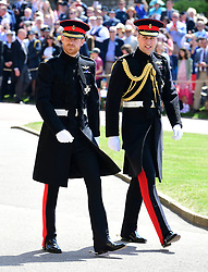 Prince Harry (left) and The Duke of Cambridge (right) arrive at St George's Chapel at Windsor Castle for the wedding of Meghan Markle and Prince Harry.