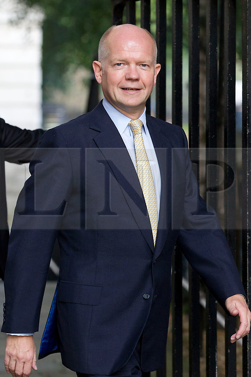 """© Licensed to London News Pictures. 29/08/2013. London, UK. William Hague, the Foreign Secretary arrives for a meeting of the British cabinet on Downing Street in London today (29/08/2013) as a recalled British Parliament prepares to debate the possibility of """"direct"""" military action over recent reports an alleged chemical weapons attack in Syria. Photo credit: Matt Cetti-Roberts/LNP"""