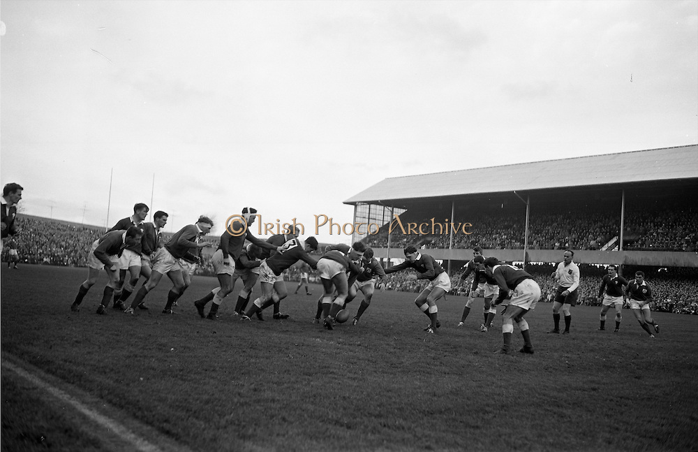 Irish forwards, Mulcahy and Mc Bride lead a dangerous foot rush,..Irish Rugby Football Union, Ireland v Wales, Five Nations, Landsdowne Road, Dublin, Ireland, Saturday 17th November, 1962,.17.11.1962, 11.17.1962,..Referee- J A E Taylor, Scottish Rugby Union, ..Score- Ireland 3 - 3 Wales, ..Irish Team, ..T J Kiernan,  Wearing number 15 Irish jersey, Full Back, University college Cork Football Club, Cork, Ireland,  ..W R Hunter, Wearing number 14 Irish jersey, Right Wing, C I Y M S Rugby Football Club, Belfast, Northern Ireland, ..A C Pedlow, Wearing number 13 Irish jersey, Right Centre,  C I Y M S Rugby Football Club, Belfast, Northern Ireland, ..M K Flynn, Wearing number 12 Irish jersey, Left Centre, Wanderers Rugby Football Club, Dublin, Ireland, ..N H Brophy, Wearing number 11 Irish jersey, Left wing, London Irish Rugby Football Club, Surrey, England, ..M A English, Wearing number 10 Irish jersey, Stand Off, Landsdowne Rugby Football Club, Dublin, Ireland, ..J C Kelly, Wearing number 9 Irish jersey, Scrum Half, University College Dublin Rugby Football Club, Dublin, Ireland, ..M P O'Callaghan, Wearing number 1 Irish jersey, Forward, Sundays Well Rugby Football Club, Cork, Ireland, ..A R Dawson, Wearing number 2 Irish jersey, Forward, Wanderers Rugby Football Club, Dublin, Ireland, ..P J Dwyer, Wearing number 3 Irish jersey, Forward, University College Dublin Rugby Football Club, Dublin, Ireland, ..W J McBride, Wearing number 4 Irish jersey, Forward, Ballymena Rugby Football Club, Antrim, Northern Ireland,..W A Mulcahy, Wearing number 5 Irish jersey, Captain of the Irish team, Forward, Bective Rangers Rugby Football Club, Dublin, Ireland,  ..P J A O'Sullivan, Wearing  Number 6 Irish jersey, Forward, Galwegians Rugby Football Club, Galway, Ireland, ..C J Dick, Wearing number 8 Irish jersey, Forward, Ballymena Rugby Football Club, Antrim, Northern Ireland, ..M D Kiely, Wearing number 7 Irish jersey, Forward, Landsdowne Rugby Football Club, Dublin, Ireland, ..Welsh Tea