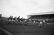 Irish forwards, Mulcahy and Mc Bride lead a dangerous foot rush,..Irish Rugby Football Union, Ireland v Wales, Five Nations, Landsdowne Road, Dublin, Ireland, Saturday 17th November, 1962,.17.11.1962, 11.17.1962,..Referee- J A E Taylor, Scottish Rugby Union, ..Score- Ireland 3 - 3 Wales, ..Irish Team, ..T J Kiernan,  Wearing number 15 Irish jersey, Full Back, University college Cork Football Club, Cork, Ireland,  ..W R Hunter, Wearing number 14 Irish jersey, Right Wing, C I Y M S Rugby Football Club, Belfast, Northern Ireland, ..A C Pedlow, Wearing number 13 Irish jersey, Right Centre,  C I Y M S Rugby Football Club, Belfast, Northern Ireland, ..M K Flynn, Wearing number 12 Irish jersey, Left Centre, Wanderers Rugby Football Club, Dublin, Ireland, ..N H Brophy, Wearing number 11 Irish jersey, Left wing, London Irish Rugby Football Club, Surrey, England, ..M A English, Wearing number 10 Irish jersey, Stand Off, Landsdowne Rugby Football Club, Dublin, Ireland, ..J C Kelly, Wearing number 9 Irish jersey, Scrum Half, University College Dublin Rugby Football Club, Dublin, Ireland, ..M P O'Callaghan, Wearing number 1 Irish jersey, Forward, Sundays Well Rugby Football Club, Cork, Ireland, ..A R Dawson, Wearing number 2 Irish jersey, Forward, Wanderers Rugby Football Club, Dublin, Ireland, ..P J Dwyer, Wearing number 3 Irish jersey, Forward, University College Dublin Rugby Football Club, Dublin, Ireland, ..W J McBride, Wearing number 4 Irish jersey, Forward, Ballymena Rugby Football Club, Antrim, Northern Ireland,..W A Mulcahy, Wearing number 5 Irish jersey, Captain of the Irish team, Forward, Bective Rangers Rugby Football Club, Dublin, Ireland,  ..P J A O'Sullivan, Wearing  Number 6 Irish jersey, Forward, Galwegians Rugby Football Club, Galway, Ireland, ..C J Dick, Wearing number 8 Irish jersey, Forward, Ballymena Rugby Football Club, Antrim, Northern Ireland, ..M D Kiely, Wearing number 7 Irish jersey, Forward, Landsdowne Rugby Football Club, Dublin, Ireland, ..Welsh Tea
