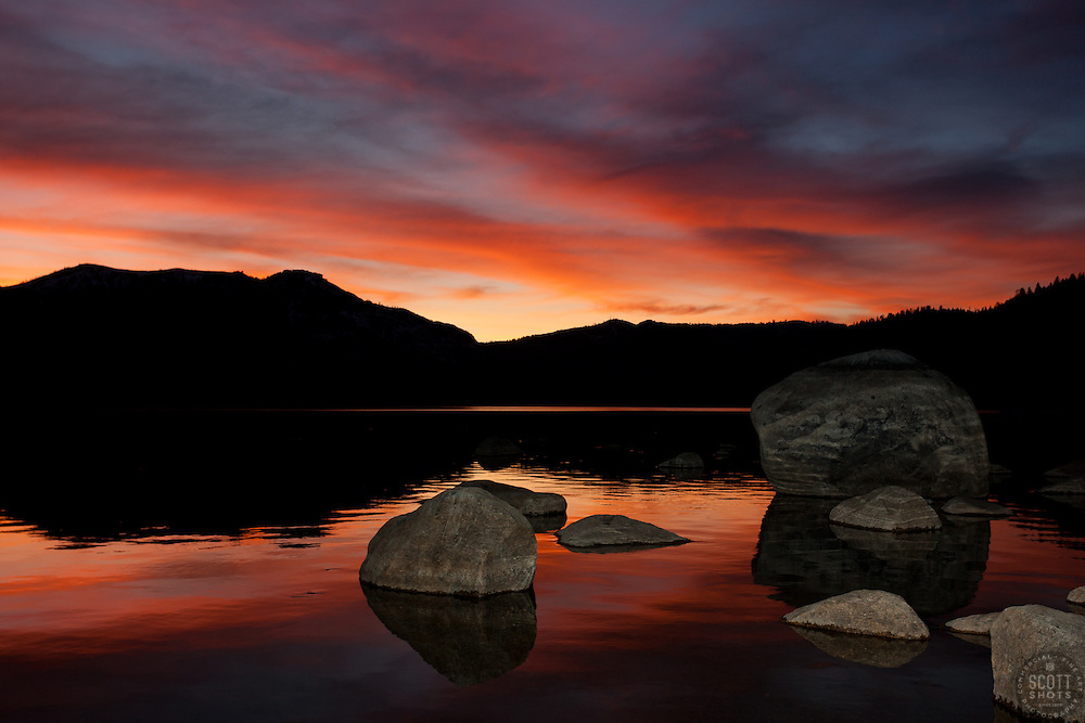 """""""Donner Lake Sunset 5"""" - Photograph of rocks and an intense sunset on the South shore of Donner Lake in Truckee, California."""