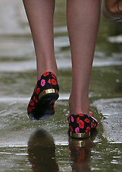© Licensed to London News Pictures. 21/10/2015. London, UK.  Home Secretary Theresa May wears shoes with a kiss motif as she leaves Number 10 Downing Street after meeting with Prime Minister David Cameron and Chinese President Xi Jinping. Photo credit: Peter Macdiarmid/LNP