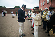Members of an order celebrating the life and death of St Knut Lavard in Landskrona, Sweden 20th of August 2016. Drinks are handed out for a toast in the court yeard of Landskronas castle.  Saint Knut Lavard was killed in 1131 and celebrations were banned in 1415 across the Danish kingdom which covered Denmark and big parts of Sweden. The celebrations were allowed to continue in 1944 and several times a year people gather in Landskrona to comemorate St Knut lavard.