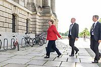 16 JUN 2020, BERLIN/GERMANY:<br /> Angela Merkel, CDU, Bundeskanzlerin, auf dem Weg zum Nordeingang, in Begleitung von Personenschuetzern des BKA, Reichstagsgebaeude, Deutscher Bundestag<br /> IMAGE: 20200616-01-005