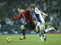 Photo: Aidan Ellis.<br /> Blackburn v Manchester United. Barclays Premiership. 01/02/2006.<br /> Blackburn's Robbie Savage chases United's Wayne Rooney